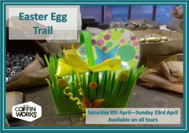 Easter Egg Trail poster. Green Easter basket with a large spotted egg sits on bench surrounded by packages and coffin handles
