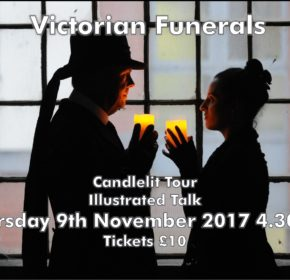 Victorian Funerals poster. Man and woman standing in front of window, they are dressed in Victorian clothing, they face each other and hold candles up in front of them.