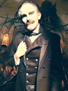 Man with moustache in suit stands in front of haunted house background