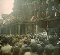 A crowd stands in front of the Council House for VE Day Celebrations, May 1945. There are world flags on display.