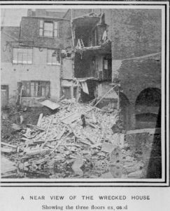 Newspaper image of the burst canal. A near view of a wrecked house